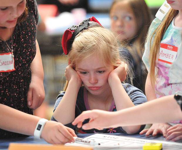 8-year old Scotten Elementary School second grader Kylie Wilson, concentrates on their sudoku game alongside her teammates Thursday afternoon at Nevada Union High School.