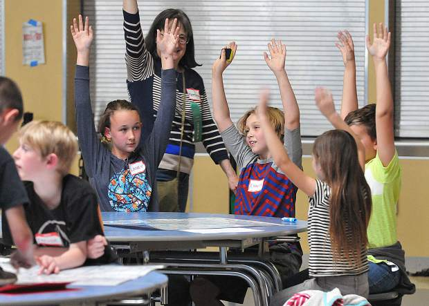 A sudoku team holds up their hands to signify their game card has been completed during Thursday's tournament at Nevada Union High School. Nearly 100 students from nine different schools competed for first through third place prizes.