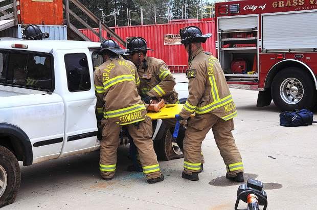 Members of the Grass Valley Fire Department demonstrate how a victim is rescued from a wrecked vehicle during Saturday's Survive The Drive event at Sierra College.