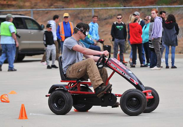 On April 27, 2018, groups of teen drivers got some valuable behind the wheel lessons during the Survive The Drive event at Sierra College. Teens either licensed or permitted took turns trying to text while driving through an obstacle course, got to see Grass Valley Firefighters use the jaws of life to extricate someone from a vehicle, as well as try to perform tasks with a variety of impairment simulating goggles.