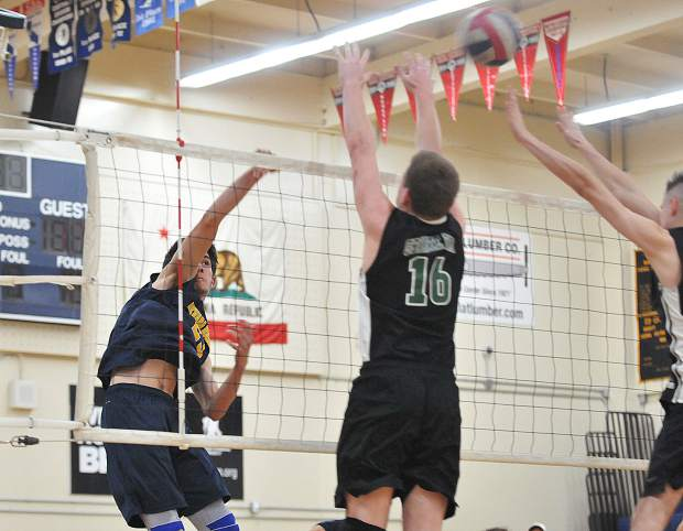 Nevada Union junior Jordan Mills spikes the ball past his Granite Bay opponents during Thursday evening's league matchup.