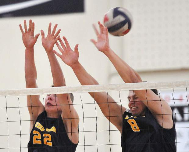 Nevada Union's Tanner Quiggle (22) and Ibrahim Torkman (8) try to block a Granite Bay spike during Thursday's matchup.