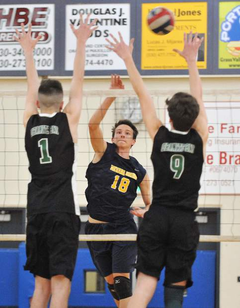Nevada Union sophomore Preston Nowak sends the ball over the Granite Bay defense during Thursday evening's league matchup at Nevada Union High School. Nowak tallied 10 kills in the match.