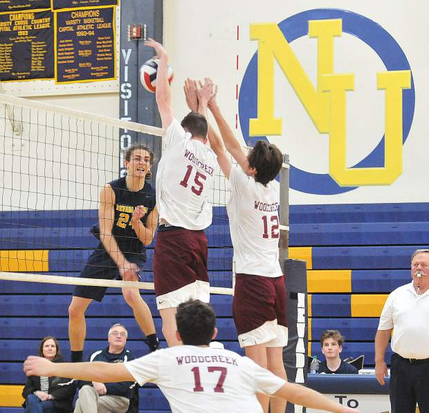 Nick Ashbaugh spikes the ball against the Woodcreek defense during Wednesday night's win at Nevada Union.