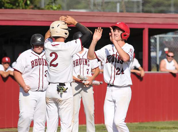 Bear River's Cole Winters (24) celebrates with his teammates after hitting a two run homerun in the 4th inning.