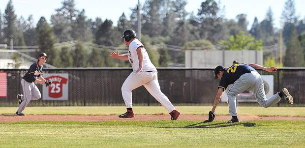 Aaron Sasville makes a dash for second base during a muffed infield play by the Western Sierra Wolves.