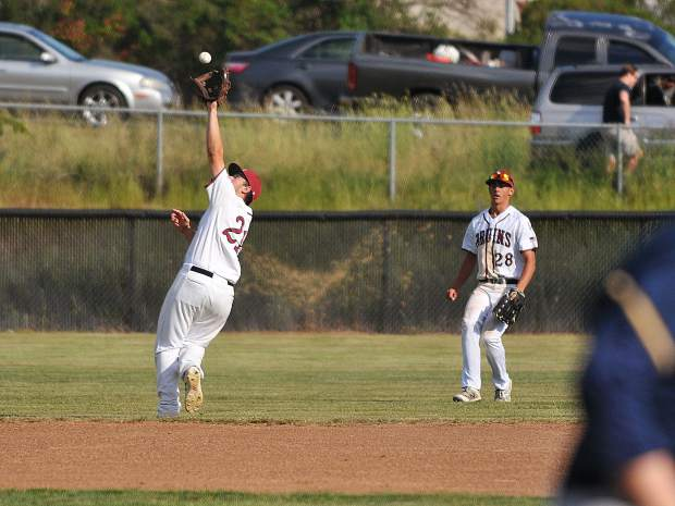 Justin Kilgore catches a pop up during the Bruins' win over the Western Sierra Wolves.
