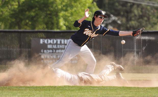 Bear River senior Jake Leonard slides safely into second base under the Western Sierra tag during Thursday's first round playoff win over the Wolves.