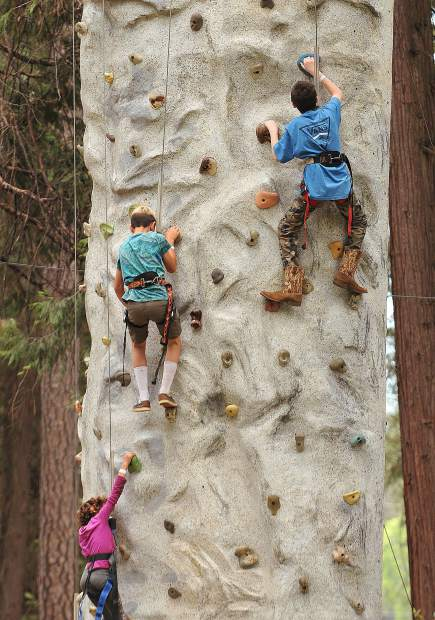Nevada County youth get active as they test their rock climbing skills on the rock wall set up at the Nevada County Fairgrounds during Grass Valley Charter School's Blue Marble Jubilee.
