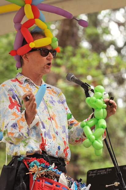 Magician and Balloon Man Albert Johnson, entertains the crowds with his zany balloon creating performances during Saturday's Blue Marble Jubilee.