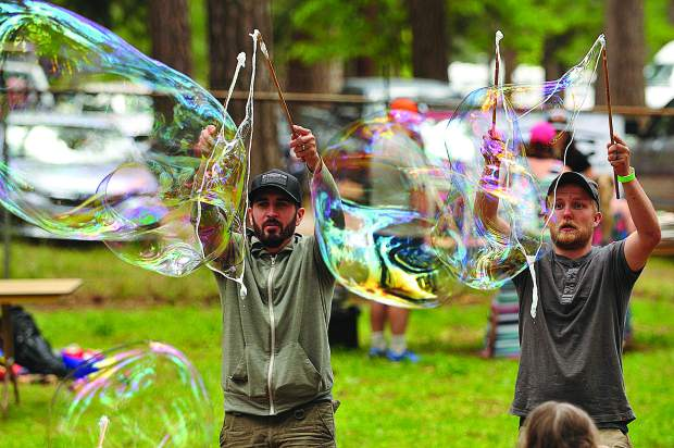 Grass Valley Charter School parents Kyle Spaulding (left) and Dalton Stephenson get into the double bubble making spirit Saturday afternoon at the Nevada County Fairgrounds during the second annual Blue Marble Jubilee, a fundraiser to benefit Grass Valley Charter School students.