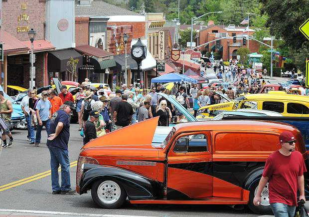 Panel wagons, Plymouths, and pickups as far as the eye can see are lined up along the Main Street portion of the Downtown Grass Valley Car Show, hosted by the Downtown Grass Valley Association.