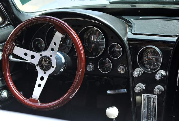 The interior of one of the many convertible sportscars sits open for inspection during the annual downtown car show.