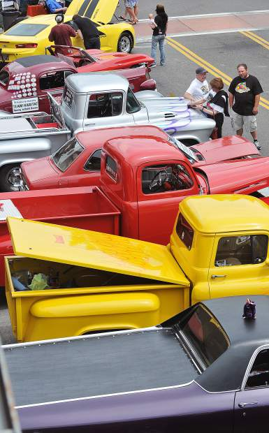 Tricked out trucks of all makes and models line this portion of Main Street in front of the Holbrooke Hotel.