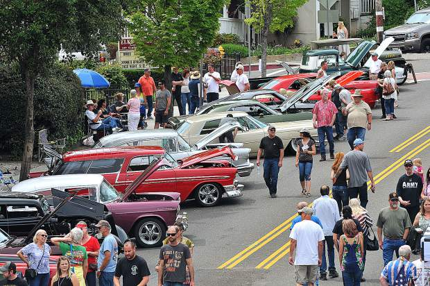 The streets of downtown Grass Valley were lined with hundreds of colorful classic cars and their enthusiasts Saturday during the annual Grass Valley Downtown Association's car show. Over 300 vehicles lined Mill and Main Streets.