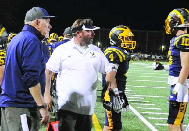 Nevada Union High School paraeducator Brad Sparks walks along the sidelines of a Nevada Union Miner Football game as an assistant coach in 2017. Sparks has been chosen to lead the 2018 Miner varsity football team after former head coach Dennis Houlihan resigned after the 2017 season.