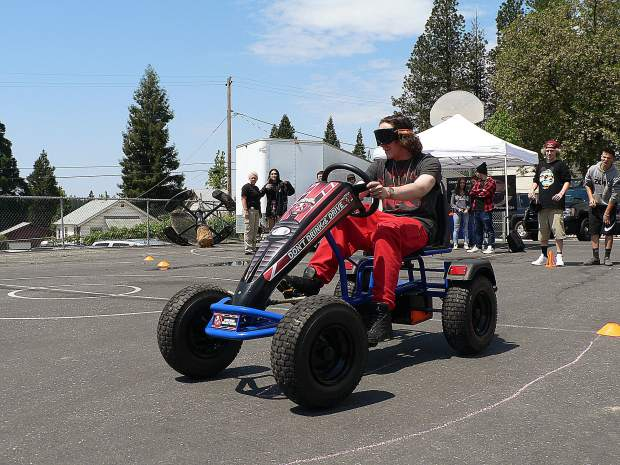Silver Springs High School sophomore Dakota Allen drives one of the Grass Valley Police Department's go-carts while wearing goggles that mimic various degrees of intoxication.