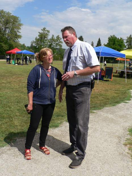Jen Rhi Winders, Health and Wellness Teen Social Worker at the Nevada County Public Health Department discusses the progress of Wednesday's Health Fair with Silver Springs High School Principal Marty Mathiesen.