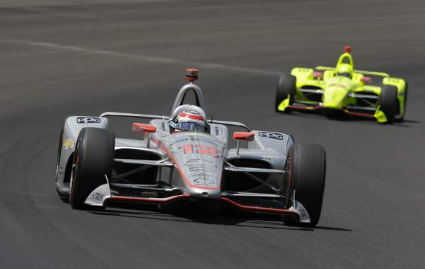 Will Power, of Australia, leads Simon Pagenaud, of France, though the first turn during the Indianapolis 500 auto race at Indianapolis Motor Speedway, in Indianapolis Sunday.