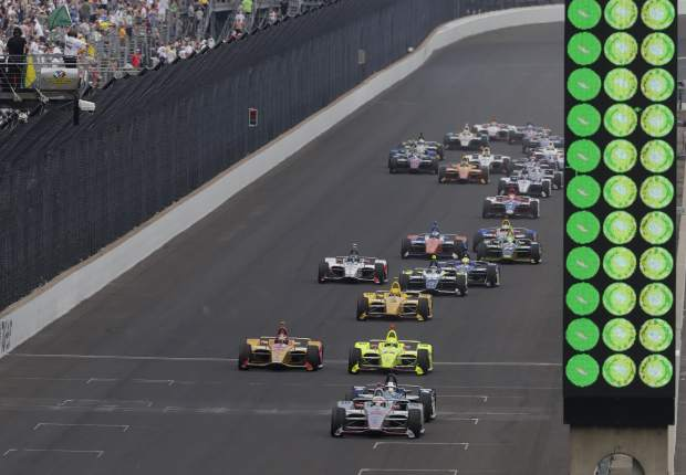 Will Power, of Australia, leads the field on a restart late in the Indianapolis 500 auto race on his way to wining at Indianapolis Motor Speedway in Indianapolis, Sunday.