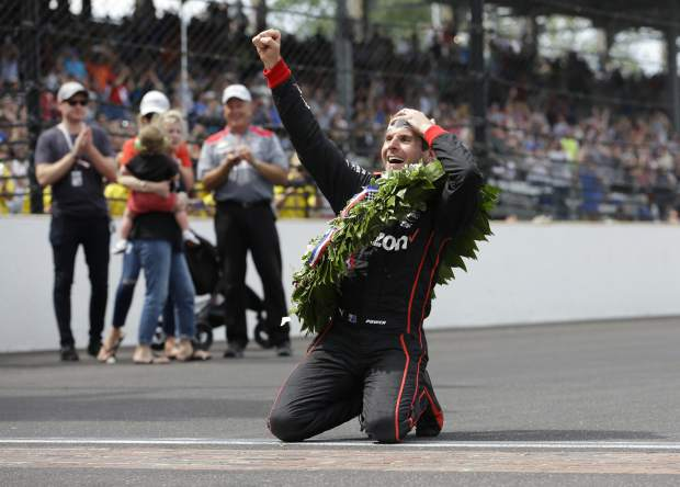 Will Power, of Australia, celebrates on the start/finish line after winning the Indianapolis 500 auto race at Indianapolis Motor Speedway, in Indianapolis Sunday.