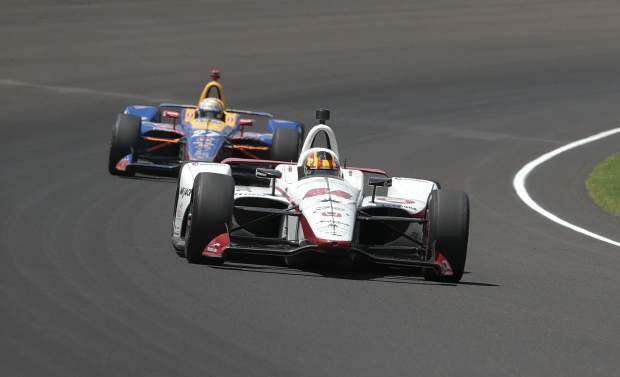 Alexander Rossi trails Oriol Servia through a turn during the Indianapolis 500 auto race at Indianapolis Motor Speedway in Indianapolis, Sunday.