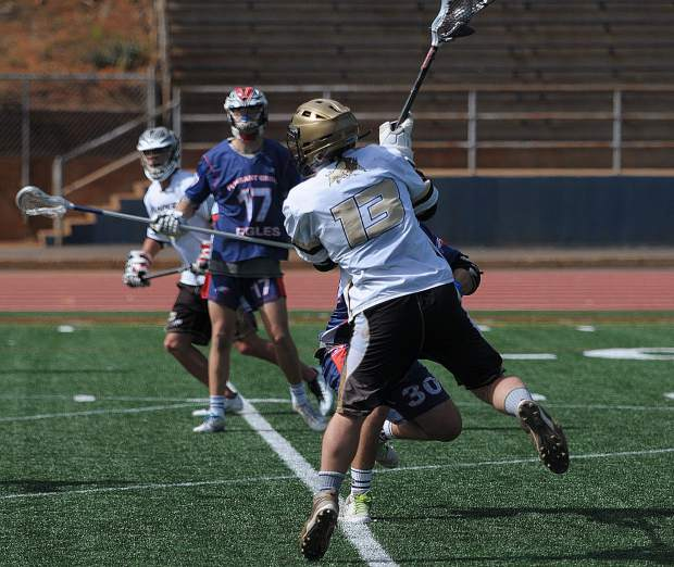 Gold Country Stampede attackman Drew Heaps leaps before scoring one of his team-high seven goals against Pleasant Grove Sunday at Hooper Stadium.
