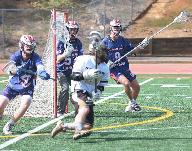 Gold Country Stampede attackman Drew Heaps circles the cage before scoring one of his team-high seven goals against Pleasant Grove Sunday at Hooper Stadium.
