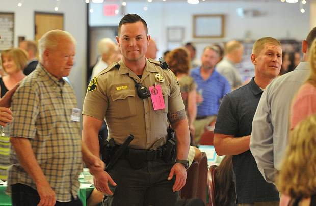 Nevada County Sheriff's deputy Brandon Cody smiles while attending Friday's Law Enforcement Appreciation Dinner held at the Nevada City Elks Lodge. The free dinner was offered to all current and retired law enforcement officers in appreciation of their service to the community.