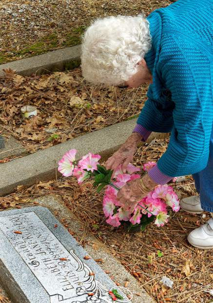 Irene Flynn came from Ukiah with family to visit the grave site of her mother, Elizabeth Rothery, at Greenwood Memorial Gardens on Rough and Ready Highway Saturday.