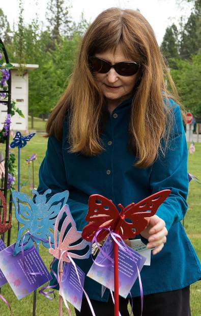 Sandy Blake of Friends of Hospice adds a memorial card on a butterfly, Saturday morning. During Memorial Day weekend, the Friends of Hospice Butterfly Garden is presented at Hooper & Weaver Mortuary on Hollow Way in Nevada City. The garden, in its 18th year, is open 10 a.m.-4 p.m. Monday.