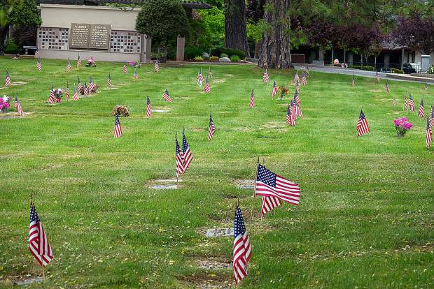 American flags acknowledge each veteran's grave at Hooper & Weaver Mortuary on Hollow Way in Nevada City.