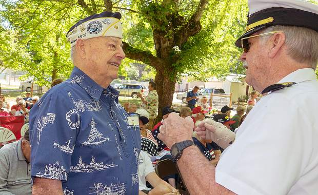Capt G.L. Cap. Wallington, U.S. Naval Academy (right), talks to Lou Conter, a survivor of the bombing of Pearl Harbor on the USS Arizona, at a barbecue lunch that followed the Memorial Day ceremony Monday at Memorial Park.