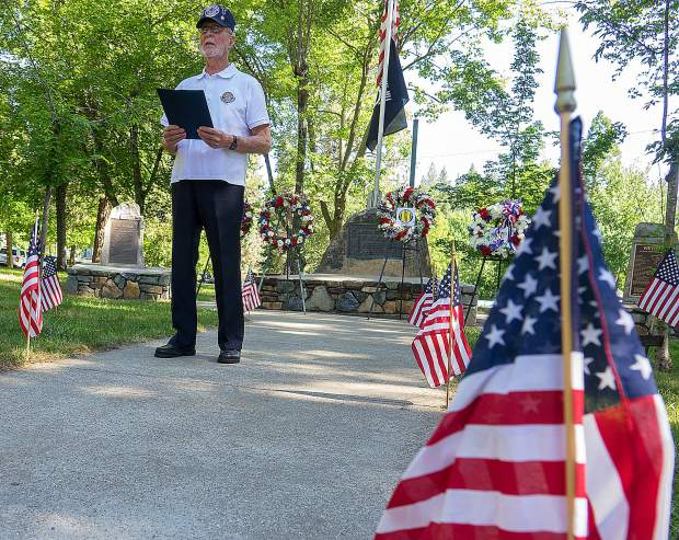 "Veterans of Foreign Wars Post 2655 hosted a Memorial Day ceremony at Pioneer Park in Nevada City Monday morning. Dale Epps, U.S. Air Force Ret., shares ""The Long Road Home,"" a story of traveling to Hanoi to pick up 11 deceased POWs remains."