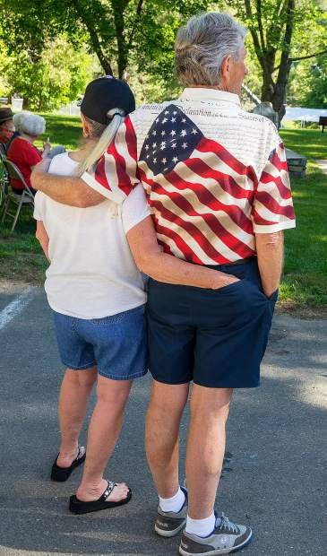 Veterans of Foreign Wars Post 2655 hosted a Memorial Day ceremony at Pioneer Park in Nevada City Monday morning. Couple waits for the ceremony to start.