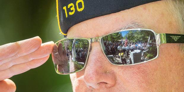Commander Scott Rosenkild salutes during the singing of the National Anthem by Bren Altenbach. The Frank Gallino American Legion Post 130 hosted a Memorial Day program at Memorial Park Monday in Grass Valley.