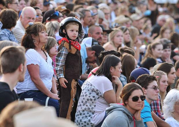 Five-year-old Richard Herrera IV looks onto the Penn Valley Rodeo Grounds as he awaits his first chance to compete at the