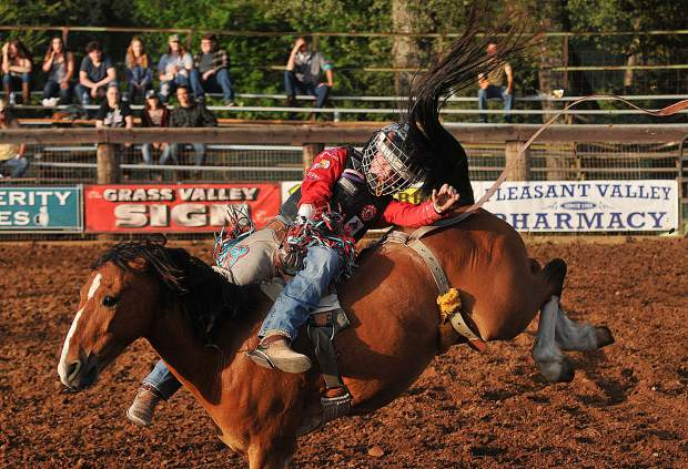 Twelve year old Tate Crooks from Browns Valley, holds on tight as he competes in the Penn Valley Rodeo's first ever Junior Bronc Riding competition.