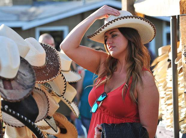 Loomis' Ali Hill tries on a new cowboy hat Friday at the Penn Valley Rodeo Grounds.