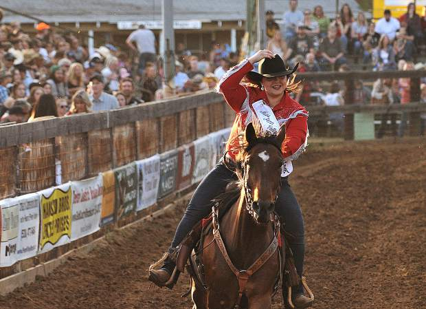 The 2018 Penn Valley Rodeo Queen Jordan Smith rides around the rodeo grounds arena prior to being named queen during Friday night's opening festivities.
