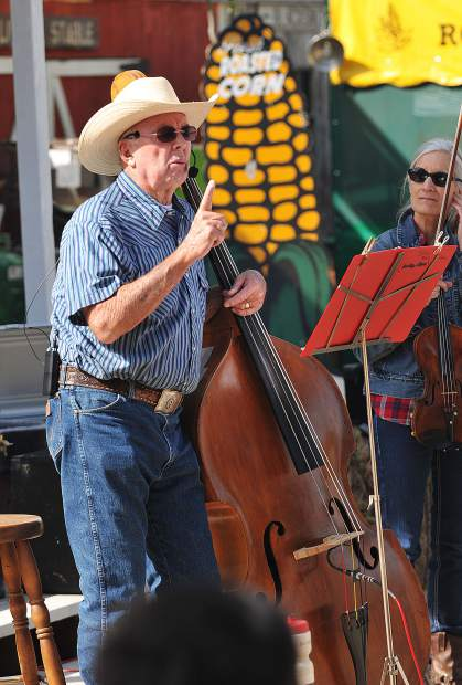 Dan Hale takes a break from playing the double bass to offer some lessons from scripture during Sunday's Cowboy Church at the Penn Valley Rodeo Grounds.
