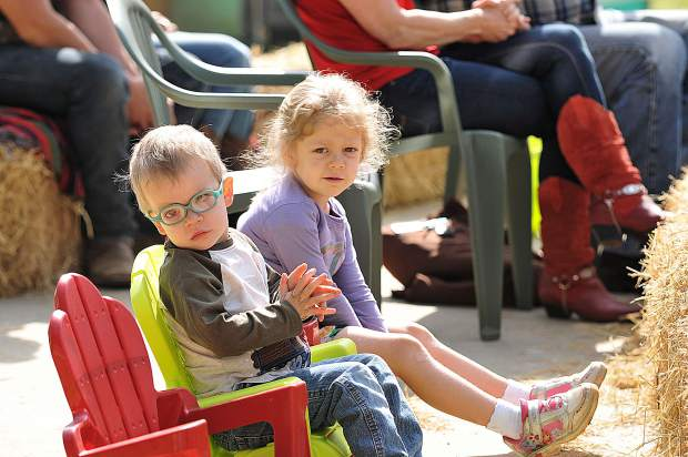 A pair of youngsters clap along to the music during Sunday's Cowboy Church at the Penn Valley Rodeo Grounds.