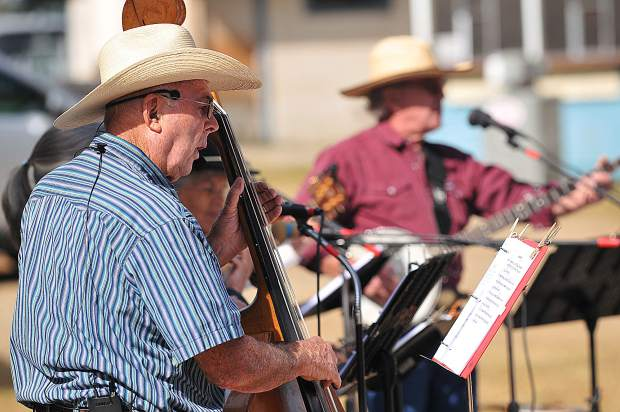 Double bassist Dan Hale plucks the strings of his instrument while offering back up vocals during Sunday's Cowboy Church at the Penn Valley Rodeo Grounds.