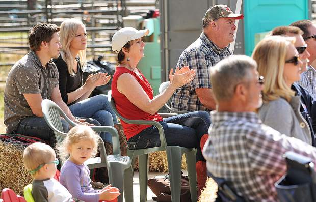 Attendees of Sunday's Cowboy Church clap along to the music at the Penn Valley Rodeo Grounds.