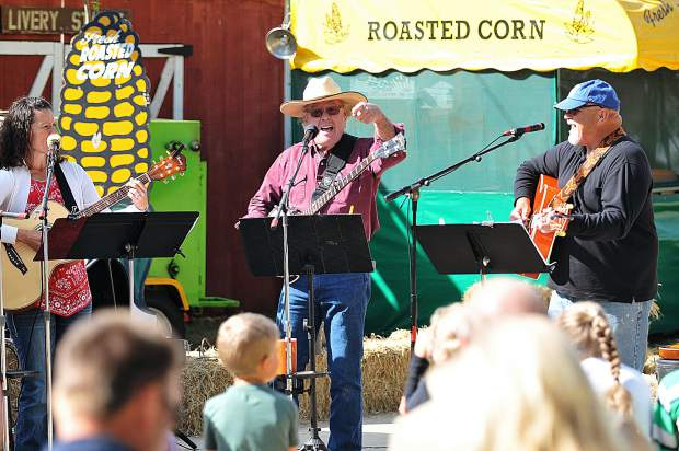 Tom Hale (center), flanked by Sue Bartow on guitar and Mike Sheesley on mandolin, play along with other members of Hale's band during Sunday morning's christian based Cowboy Church at the Penn Valley Rodeo Grounds.