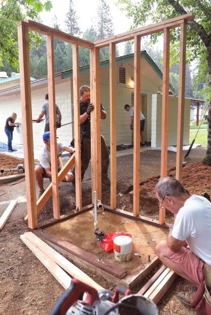 Volunteers with construction experience put up framing for a new pump shed in Grass Valley's Memorial Park Saturday morning.