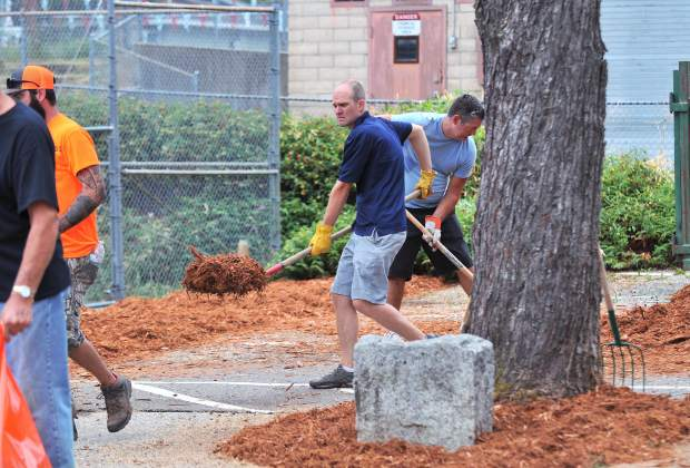 Grass Valley Chief of Police Alex Gammelgard and Councilmember Jason Fouyer get in on the action during Saturday's clean up.