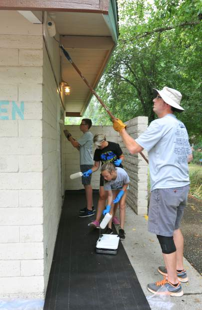 Grass Valley's Barger family gladly took time out of their Saturday morning to help paint the walls of the bathroom building at Memorial Park. The Bargers include husband and wife Sam and Jaima and their two children Kole and Kylan.