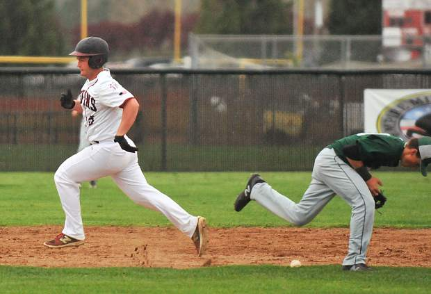 Bear River baserunner Anthony Crawford runs past the Colfax second baseman as he bobbles a play during Tuesday's loss to the Falcons at Bear River High School.