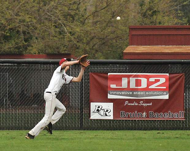 Bear River outfielder Jake Leonard makes a running catch during Tuesday's PVL matchup against the Colfax Falcons.